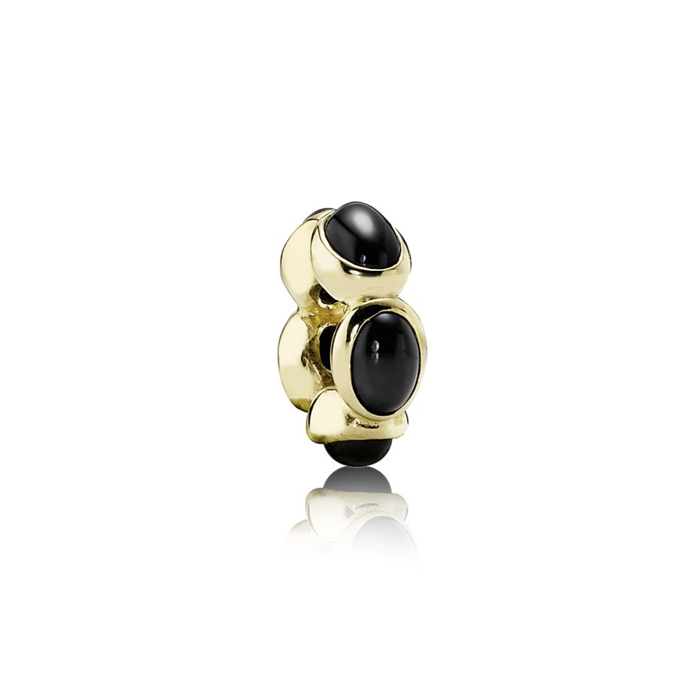 Abstract gold spacer with black onyx