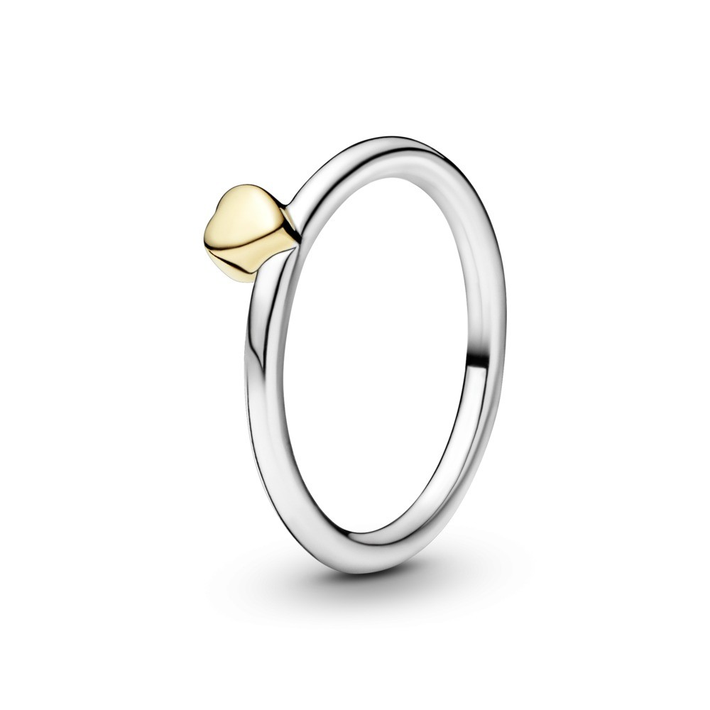 Silver ring with 14k heart